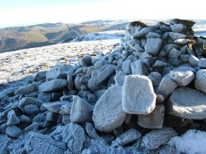 Frost covers a cairn at the summit in the Lake District