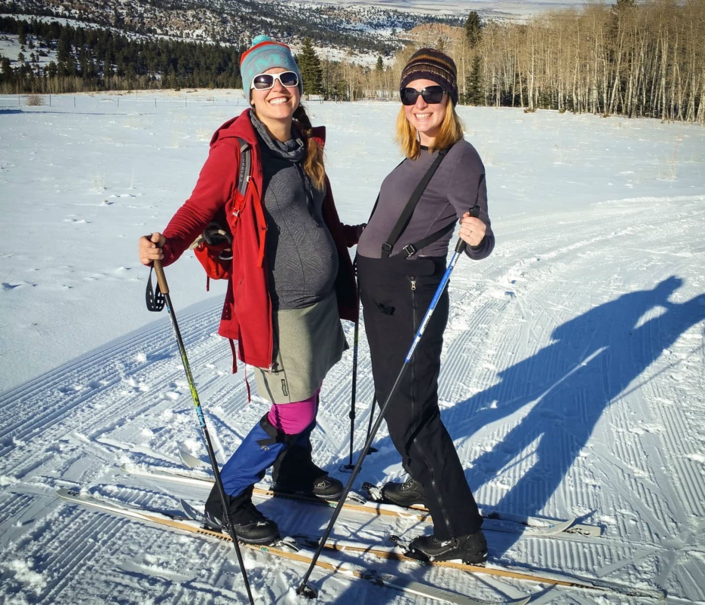 Two pregnant women cross country skiing