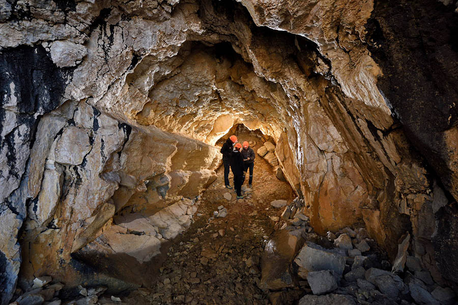 3 people inside one of the Greenland caves.