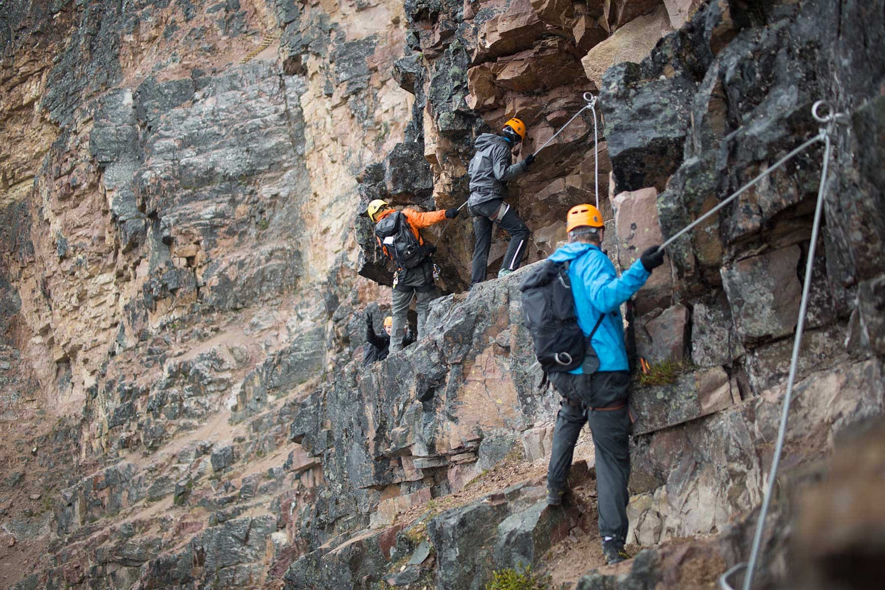 Scaling the cliffside on the via ferrata
