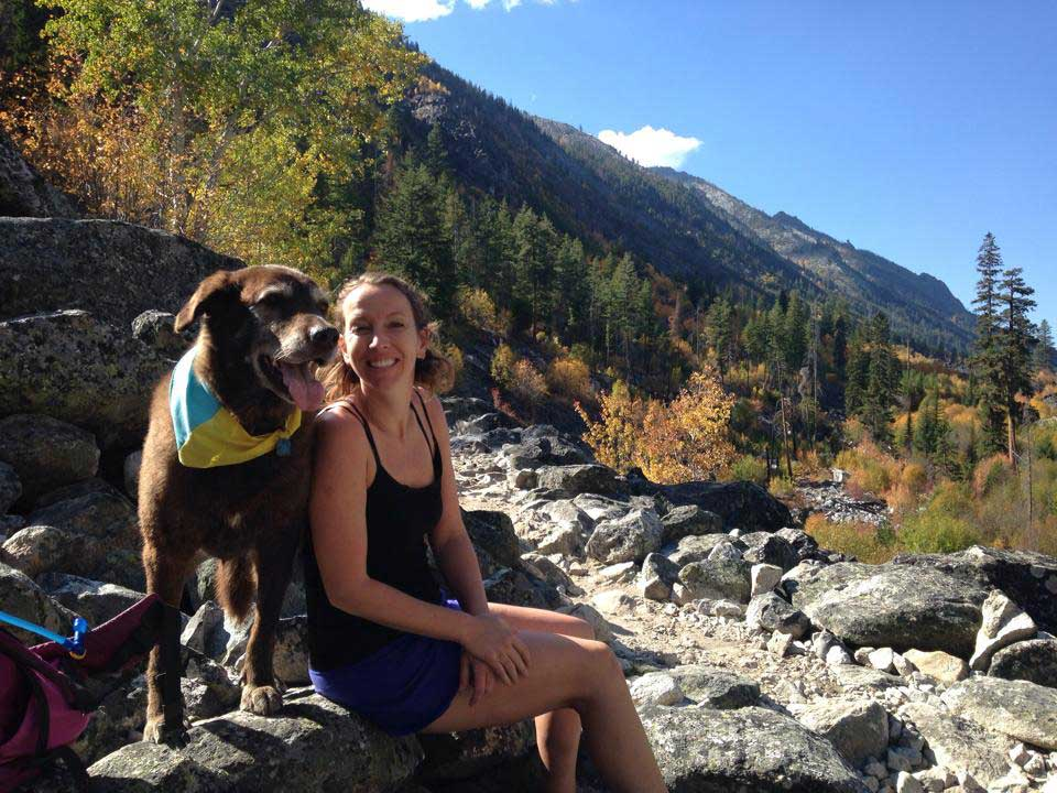 Losing a canine adventure partner - Author and her dog, Alta, in the mountains