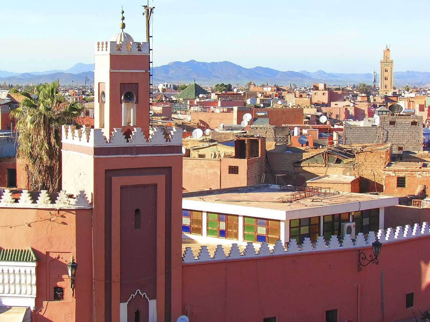 The tops of buildings and mountains in the distance in Marrakech, Morocco.