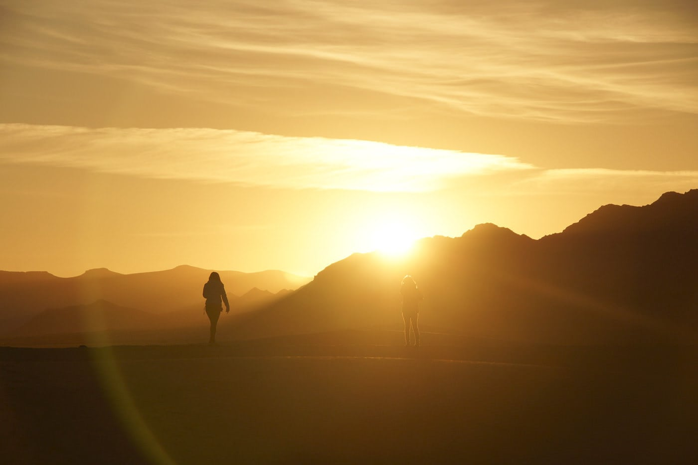 Silhouettes of two women at sunset in Morocco.