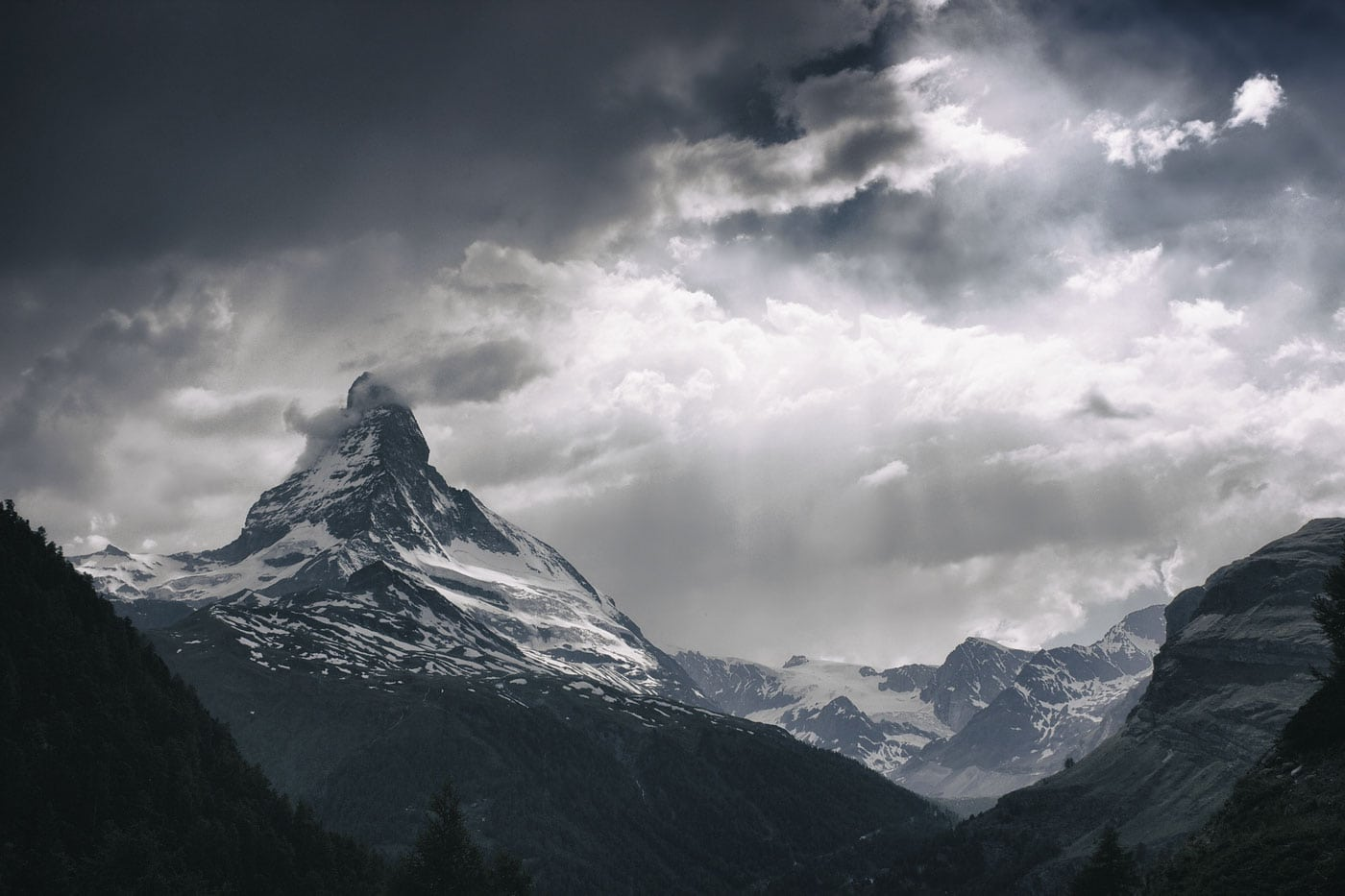 Mental health and adventure: A stormy sky and sunburst surrounding the mountains and peak of the Matterhorn