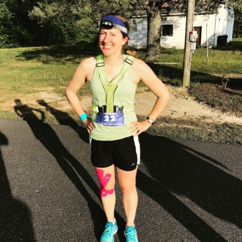 Outdoor woman Aubrey Moore wearing running gear after her spinal cord recovery.