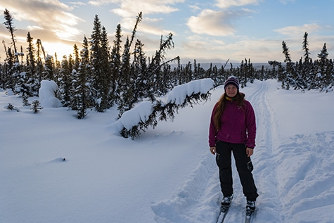 Woman cross country skiing in Alaska.